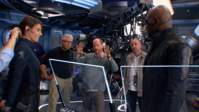Joss Whedon directing on set.